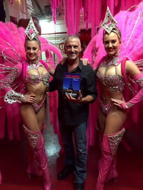Cliff – the returning hero -- with memoir in hand flanked by two beautiful dance girls at the Moulin Rouge, 2016.